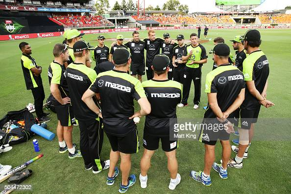 Thunder captain Michael Hussey speaks to his players before during the Big Bash League match between the Sydney Thunder and the Melbourne Renegades...