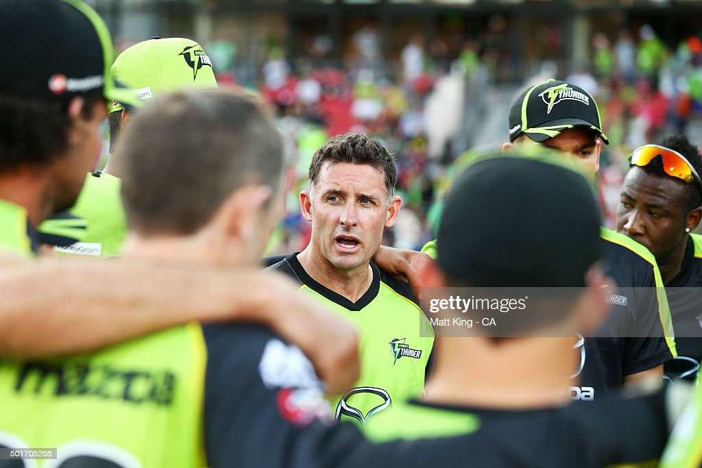 Thunder captain <a gi-track='captionPersonalityLinkClicked' href=/galleries/search?phrase=Michael+Hussey&family=editorial&specificpeople=171690 ng-click='$event.stopPropagation()'>Michael Hussey</a> speaks to his players before the Big Bash League match between the Sydney Thunder and the Sydney Sixers at Spotless Stadium on December 17, 2015 in Sydney, Australia.
