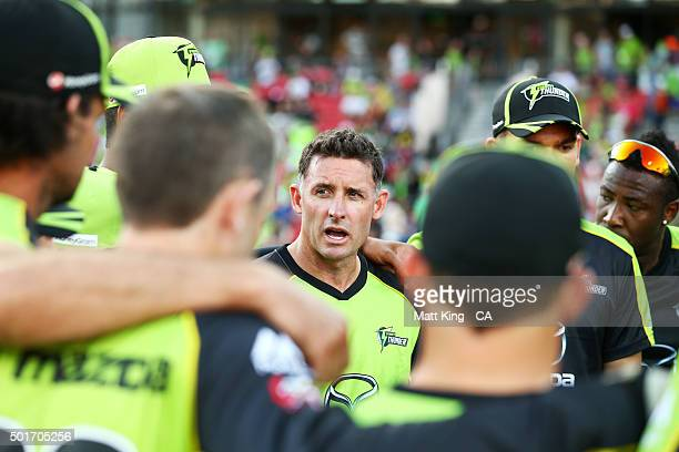 Thunder captain Michael Hussey speaks to his players before the Big Bash League match between the Sydney Thunder and the Sydney Sixers at Spotless...
