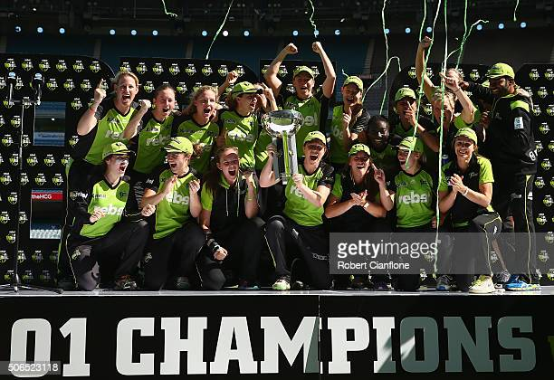 Thunder celebrate after they defeated the Sixers during the Women's Big Bash League Final match between the Sydney Thunder and the Sydney Sixers at...