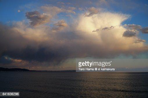Thunder cloud on the sunset beach