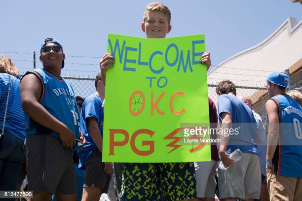 Thunder fans greet Paul George of the Oklahoma City Thunder on July 11 2017 at the Will Rogers Airport in Oklahoma City Oklahoma The Thunder acquired...