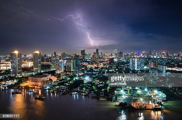 Thunder storm among skyscraper