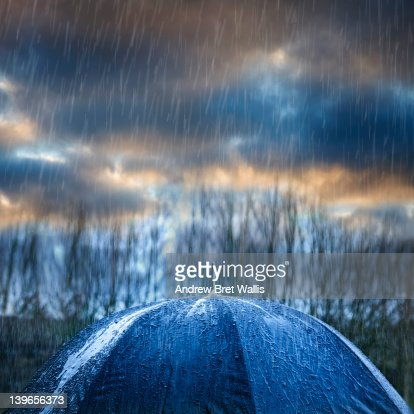 Thunderstorm and rainfall above an umbrella
