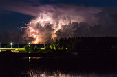 Thunderstorm cloud early in the morning, in summer in August, before sunrise, power of nature background