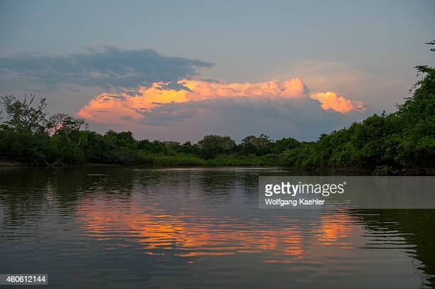 A thunderstorm is building up over the Pixaim River in the northern Pantanal Mato Grosso province of Brazil