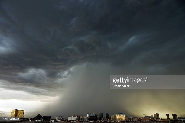 A thunderstorm is seen northwest of the Las Vegas Strip on July 6 2015 in Las Vegas Nevada The monsoon storm dropped heavy rain and hail in parts of...