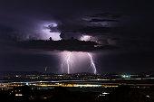 Monsoon thunderstorm with lightning bolts striking near Phoenix, Arizona.