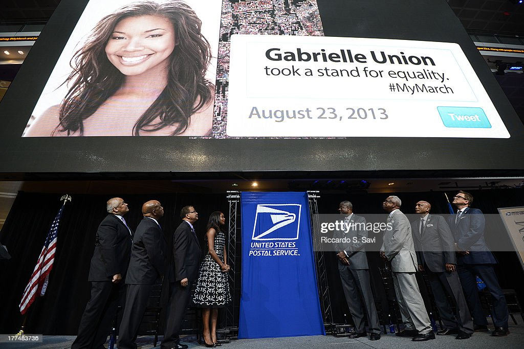 Thurgood Marshall, Jr, John Lewis, Alexander Williams, <a gi-track='captionPersonalityLinkClicked' href=/galleries/search?phrase=Gabrielle+Union&family=editorial&specificpeople=202066 ng-click='$event.stopPropagation()'>Gabrielle Union</a>, Ronald Stroman, Wade Henderson, Joe Coleman and Scott Williams attend the U.S. Postal Service Unveiling of the 1963 March On Washington Stamp on August 23, 2013 in Washington, United States.