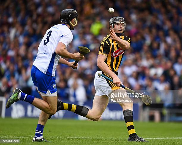 Thurles Ireland 13 August 2016 Walter Walsh of Kilkenny passes the sliothar past Waterford's full back Barry Coughlan to his team mate Colin Fennelly...