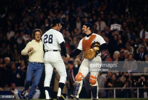 Thurman Munson of the New York Yankees congratulates reliever Sparky Lyle after the Yankees defeated the Dodgers 43 in the first game of the World...