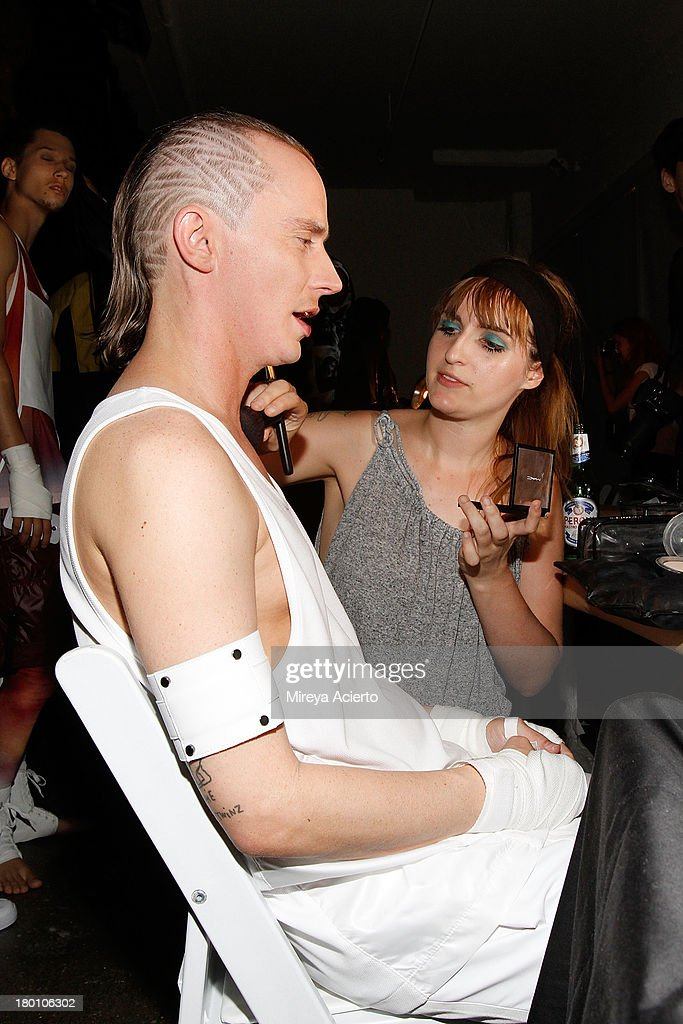 Thurman Sewell gets makeup backstage at the Rochambeau Presentation at Milk Studios on September 8, 2013 in New York City.