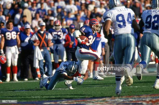 Thurman Thomas of the Buffalo Bills rushes against the Dallas Cowboys in Super Bowl 27 played at the Rose Bowl circa 1993 in PasadenaCalifornia on...