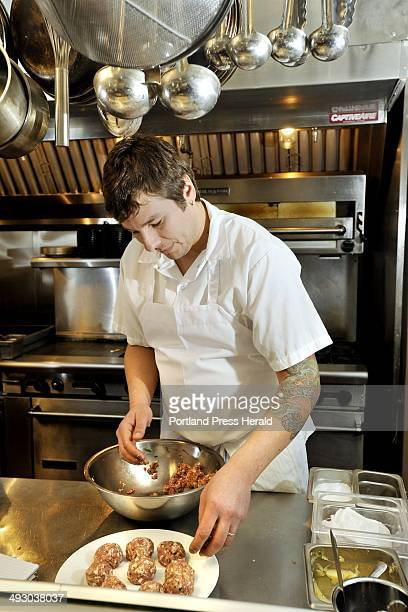 Thursday January 27 2011 Pete Sueltenfuss chef/owner of District restaurant in Portland prepares pork meatballs with a cider gravy for a Superbowl...