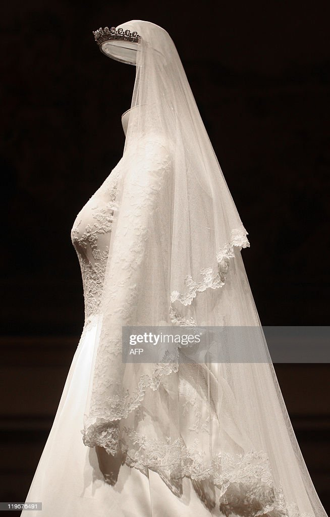 Thursday July 21, 2011 at 2301 GMT - THIS RESTRICTION APPLIES TO ALL MEDIA INCLUDING WEBSITES The wedding dress of Catherine, the Duchess of Cambridge, is pictured at Buckingham Palace, in central London, on July 20, 2011. It was the best kept secret of the royal wedding, but now the Alexander McQueen dress worn by the Duchess of Cambridge when she married Prince William is being put on public display for all to admire. Catherine's ivory and white satin-gazar dress, designed by Sarah Burton, goes on show at Buckingham Palace on Saturday as part of the annual summer opening, where hundreds of thousands of visitors are expected to flock to see it. One million people lined the streets of London to see William and the former Kate Middleton marry on April 29, but few will have got close enough to appreciate the intense effort that went into the stunning gown. AFP PHOTO / LEWIS WHYLD / WPA POOL