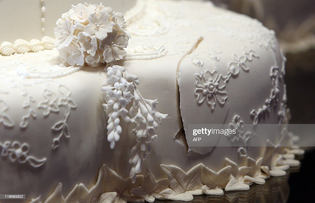 Thursday July 21, 2011 at 2301 GMT - THIS RESTRICTION APPLIES TO ALL MEDIA INCLUDING WEBSITES The first cut made by the Duke and Duchess of Cambridge in the royal wedding cake is pictured at Buckingham Palace, in central London, on July 20, 2011. It was the best kept secret of the royal wedding, but now the Alexander McQueen dress worn by the Duchess of Cambridge when she married Prince William is being put on public display for all to admire. Catherine's ivory and white satin-gazar dress, designed by Sarah Burton, goes on show at Buckingham Palace on Saturday as part of the annual summer opening, where hundreds of thousands of visitors are expected to flock to see it. One million people lined the streets of London to see William and the former Kate Middleton marry on April 29, but few will have got close enough to appreciate the intense effort that went into the stunning gown. AFP PHOTO / LEWIS WHYLD / WPA POOL