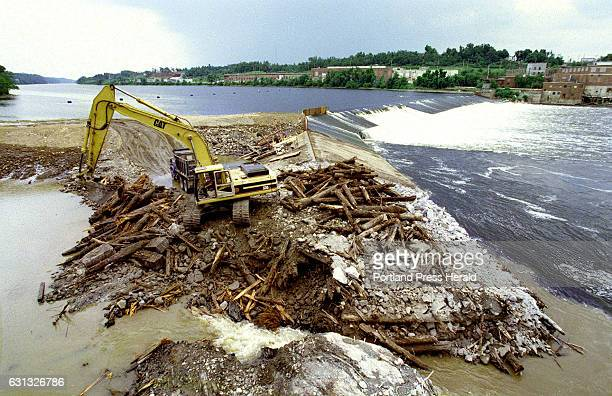 Thursday June 24 1999 A backhoe begins work on removing the 850 ft long Edwards Dam in Augusta Maine built in 1837 and constructed of a cribwork of...