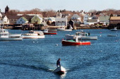 PATRIQUIN Thursday March 13 1997 A Vinalhaven fisherman heads for shore in Carver's harbor the hub of activity on the island