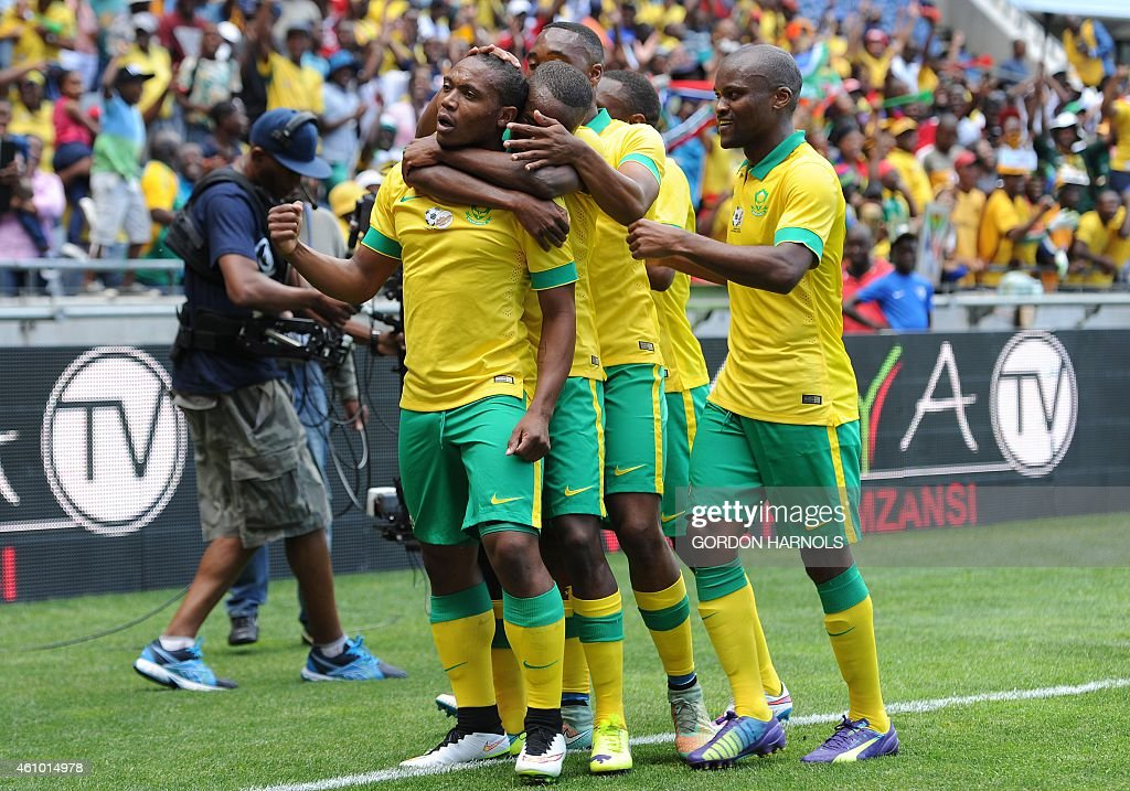 <a gi-track='captionPersonalityLinkClicked' href=/galleries/search?phrase=Thuso+Phala&family=editorial&specificpeople=4422095 ng-click='$event.stopPropagation()'>Thuso Phala</a> (L) of South Africa celebrates with his teammates after scoring a goal during the friendly football match between Zambia and South Africa at Orlando Stadium in Johannesburg on January 4, 2015. AFP PHOTO/GORDON HARNOLS