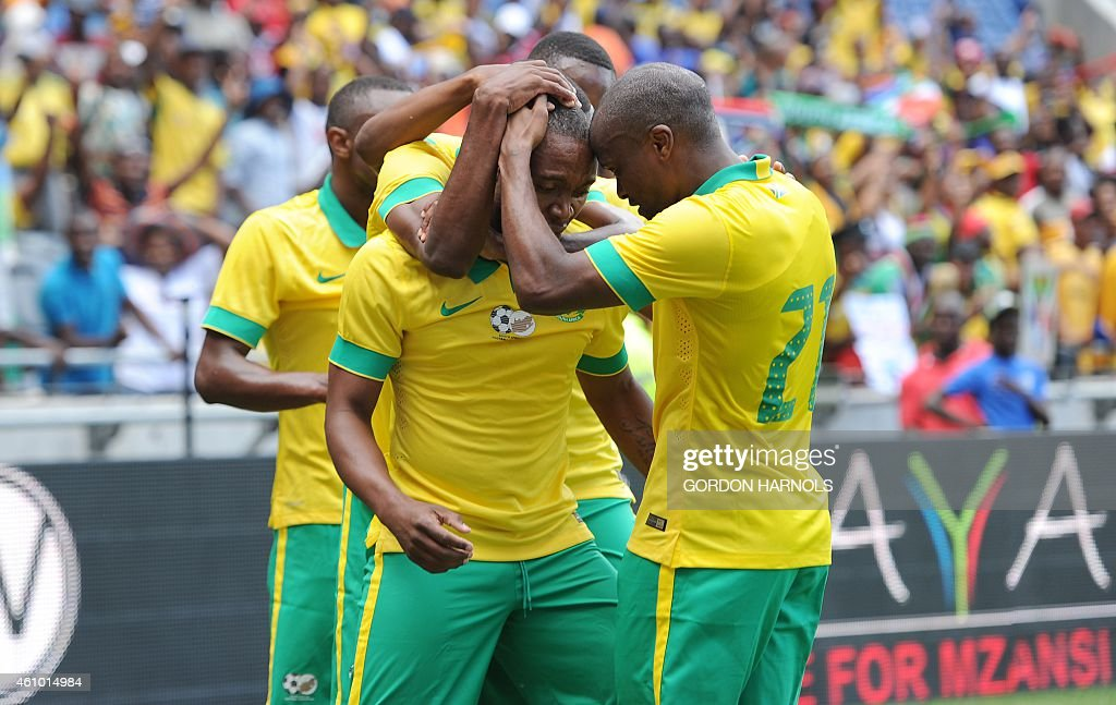 <a gi-track='captionPersonalityLinkClicked' href=/galleries/search?phrase=Thuso+Phala&family=editorial&specificpeople=4422095 ng-click='$event.stopPropagation()'>Thuso Phala</a> (C) of South Africa celebrates with his teammates after scoring a goal during the friendly football match between Zambia and South Africa at Orlando Stadium in Johannesburg on January 4, 2015. AFP PHOTO/GORDON HARNOLS