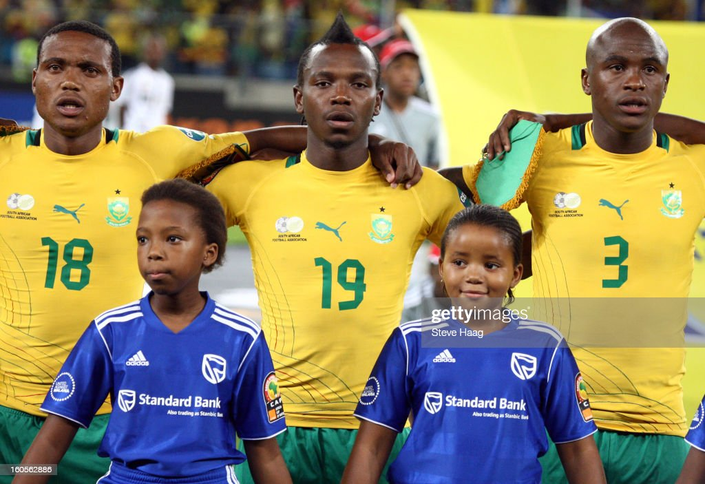 Thuso Phala of South Africa with May Mahlangu of South Africa and Tsepo Masilela of South Africa during the 2013 African Cup of Nations Quarter-Final match between South Africa and Mali at Moses Mahbida Stadium on February 2, 2013 in Durban, South Africa.