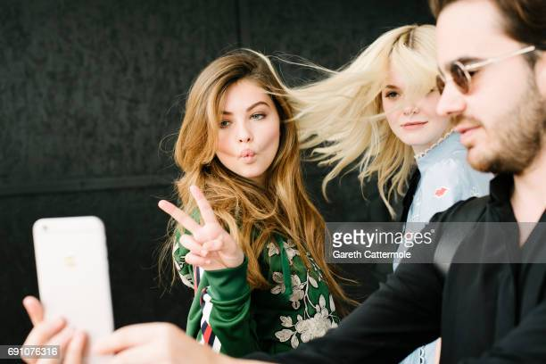 Thylane Blondeau and Elle Fanning are photographed at the L'Oreal Paris Beach Studio during the 70th annual Cannes Film Festival on May 18 2017 in...