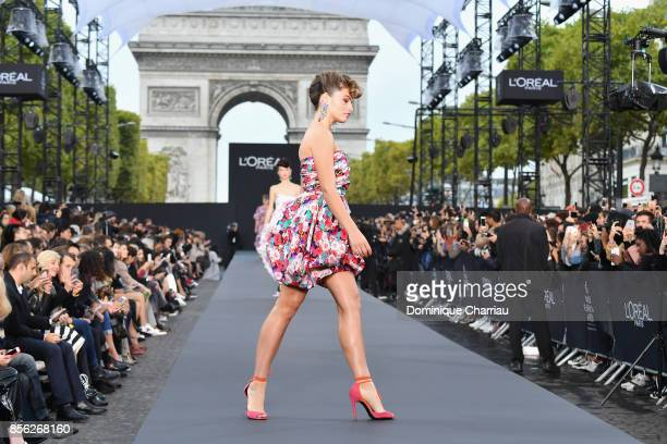 Thylane Blondeau walks the runway during the Le Defile L'Oreal Paris show as part of the Paris Fashion Week Womenswear Spring/Summer 2018 on October...
