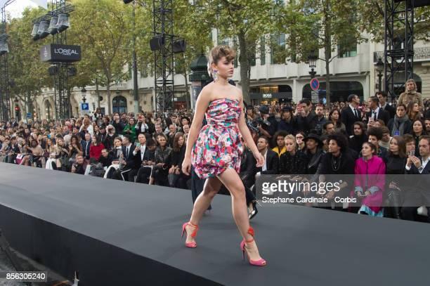 Thylane Blondeau walks the runway during the Le Defile L'Oreal Paris Spring Summer 2018 show as part of Paris Fashion Week at Avenue des...