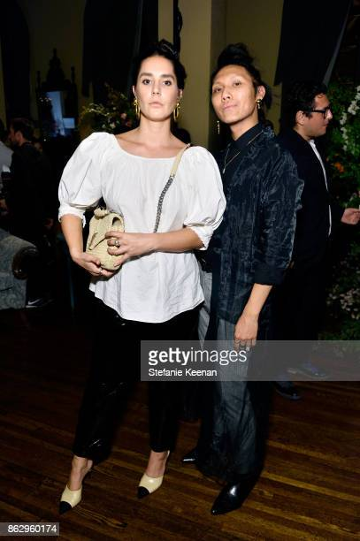 Tia Arobio and Tim Nguyen at HM x ERDEM Runway Show Party at The Ebell Club of Los Angeles on October 18 2017 in Los Angeles California