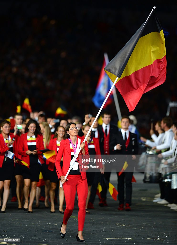 <a gi-track='captionPersonalityLinkClicked' href=/galleries/search?phrase=Tia+Hellebaut&family=editorial&specificpeople=597909 ng-click='$event.stopPropagation()'>Tia Hellebaut</a> of the Belgium Olympic athletics team carries her country's flag during the Opening Ceremony of the London 2012 Olympic Games at the Olympic Stadium on July 27, 2012 in London, England.