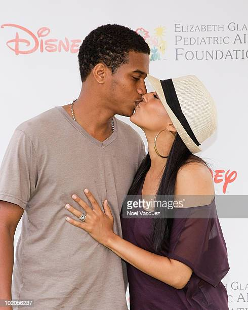 Tia Mowry and Cory Hardrict kiss at the 21st annual 'A Time For Heroes' celebrity picnic at the Wadsworth Theater on June 13 2010 in Los Angeles...