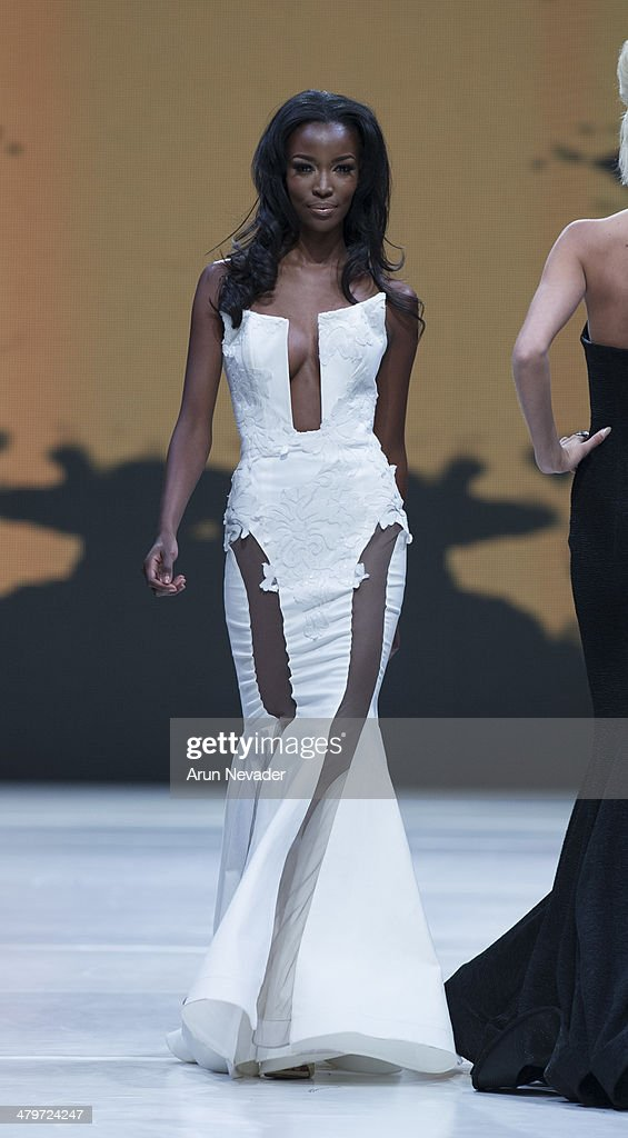 Tia Shipman walks the runway for the Michael Costello Couture fashion show fall 2014 during Project Runway at El Paseo Fashion Week 2014 on March 19, 2014 in Palm Desert, California.