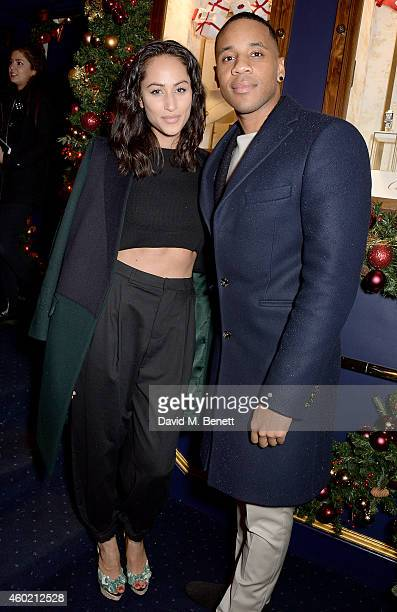 Tia Ward and Reggie Yates attend the Sunday Times Style Xmas Party at Tramp on December 9 2014 in London England