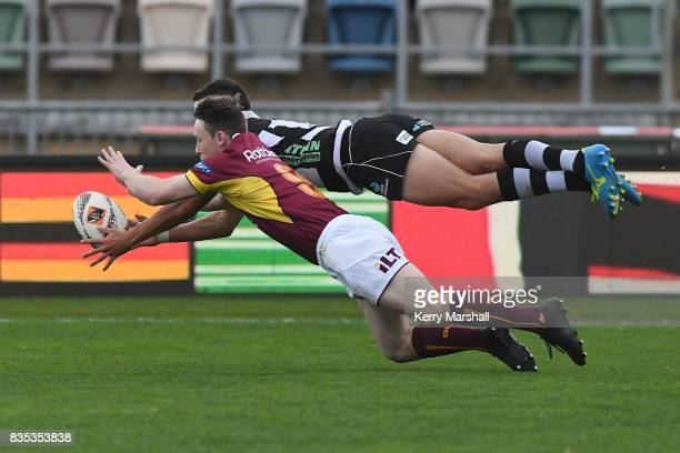 Tiaan Falcon of Hawke's Bay dives and beats Jay Renton of Southland to score a try during the round one Mitre 10 Cup match between the Hawke's Bay...