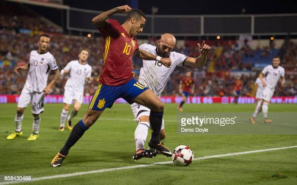Tiago Alcantara of Spain is tackled by Arlind Ajeti of Albania during the FIFA 2018 World Cup Qualifier between Spain and Albania at Estadio Jose...