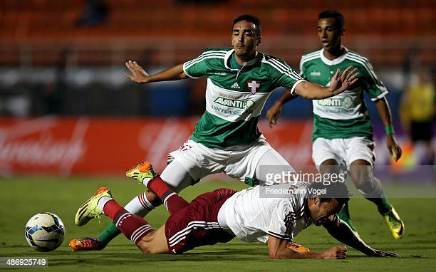Tiago Alves of Palmeiras fights for the ball with Fred of Fluminense during the match between Palmeiras and Fluminense for the Brazilian Series A...