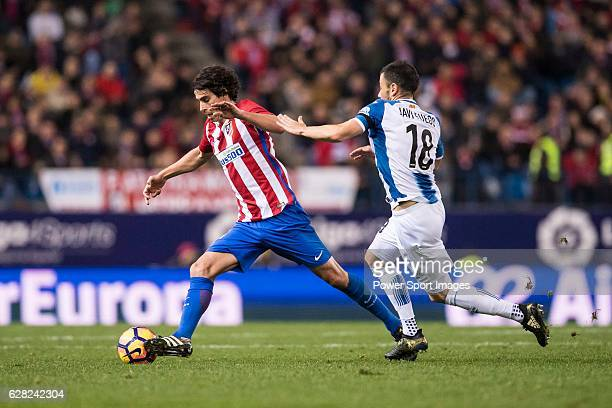 Tiago Cardoso Mendes of Atletico de Madrid competes for the ball with Javi Fuego of RCD Espanyol during the La Liga match between Atletico de Madrid...