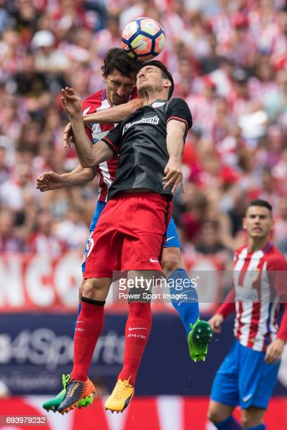 Tiago Cardoso Mendes of Atletico de Madrid competes for the ball with Aritz Aduriz Zubeldia of Athletic Club during the La Liga match between...