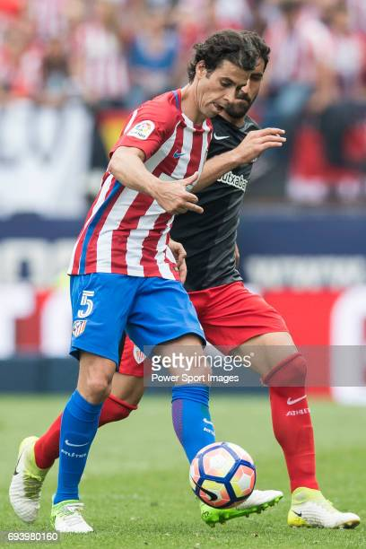 Tiago Cardoso Mendes of Atletico de Madrid fights for the ball with Raul Garcia of Athletic Club during the La Liga match between Atletico de Madrid...