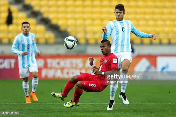 Tiago Casasola of Argentina passes through the challenge of Luis Pereira of Panama during the Group B FIFA U20 World Cup New Zealand 2015 match...