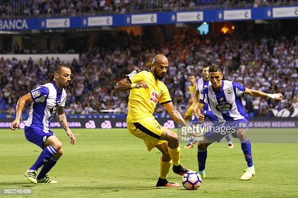 Tiago Correia quotBebequot controls the ball against Guillherme Dos Santos and Fayçal Fajr in action during the Spanish league football match Real...