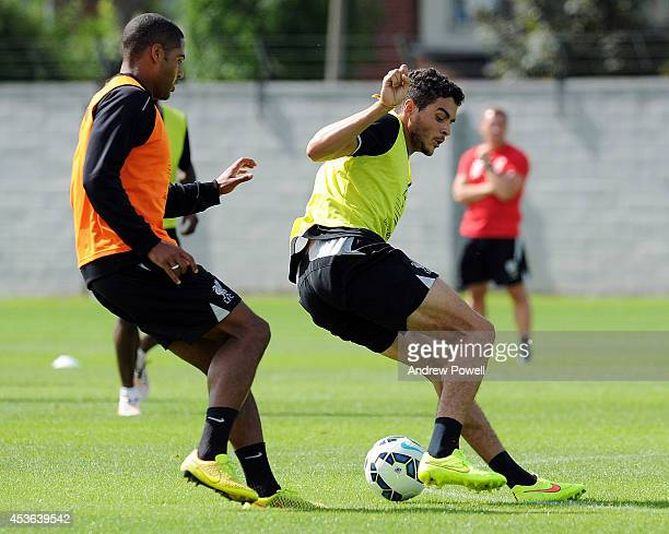 Tiago Ilori and Glen Johnson of Liverpool during a training session at Melwood Training Ground on August 15 2014 in Liverpool England