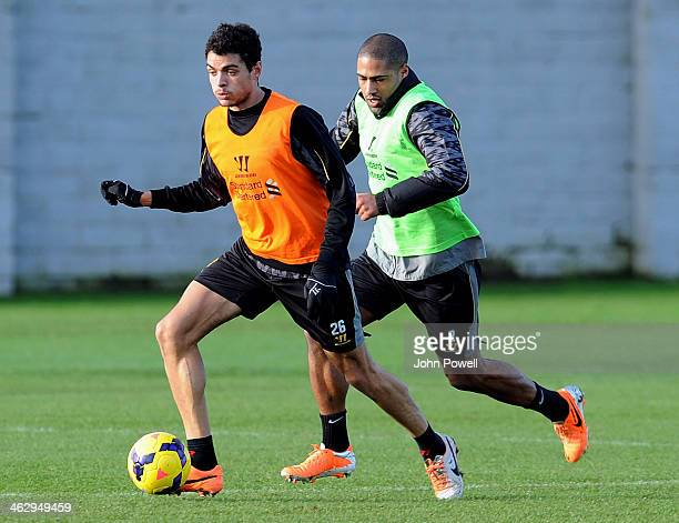 Tiago Ilori and Glen Johnson of Liverpool in action during a training session at Melwood Training Ground on January 16 2014 in Liverpool England