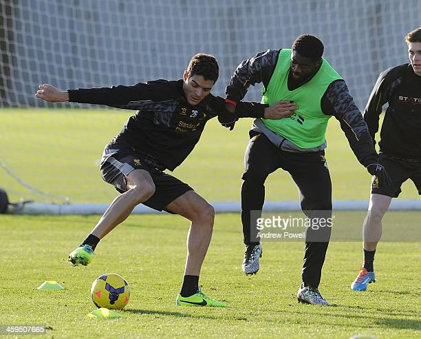 Tiago Ilori and Kolo Toure of Liverpool in action during a training session at Melwood Training Ground on December 27 2013 in Liverpool England