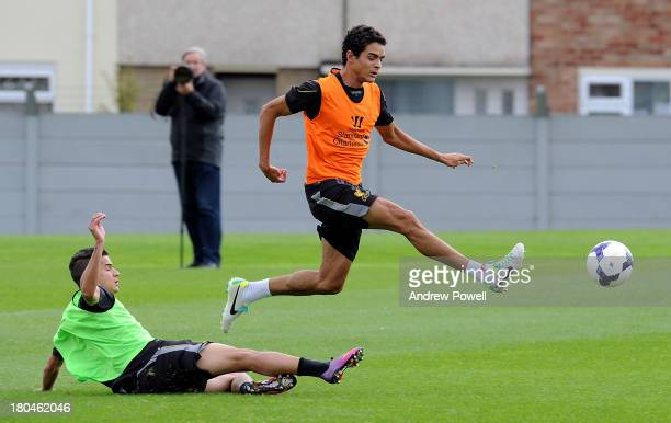 Tiago Ilori and Philippe Coutinho of Liverpool in action during a training session at Melwood Training ground on September 13 2013 in Liverpool...