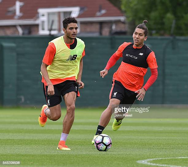 Tiago Ilori and Roberto Firmino of Liverpool during a training session at Melwood Training Ground on July 6 2016 in Liverpool England
