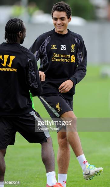 Tiago Ilori and Victor Moses of Liverpool in action during a training session at Melwood Training ground on September 13 2013 in Liverpool United...