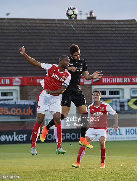 Tiago Ilori of Liverpool goes up with Nathan Pond of Fleetwood Town during the PreSeason Friendly match bewteen Fleetwood Town and Liverpool at...
