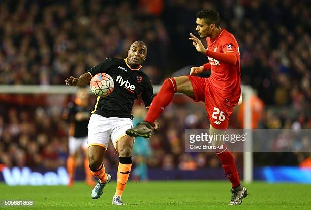 Tiago Ilori of Liverpool holds off Clinton Morrison of Exeter City during The Emirates FA Cup Third Round Replay match between Liverpool and Exeter...