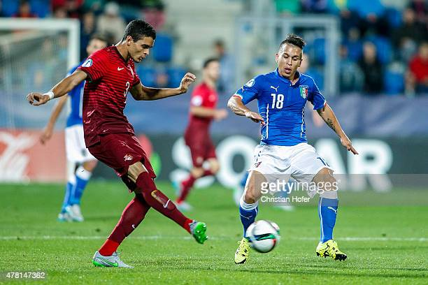 Tiago Ilori of Portugal competes for the ball with Christian Battocchio of Italy during the UEFA Under21 European Championship 2015 match between...